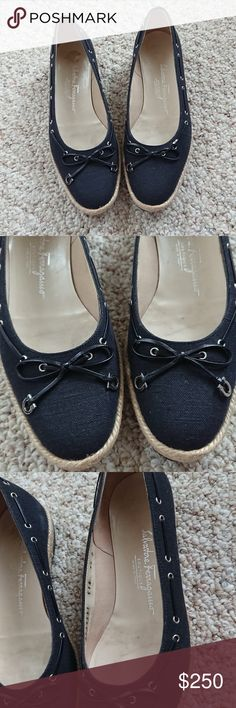 Salvatore Ferragamo Black Canvas Flats Salvatore Ferragamo Black Canvas Flats Very good used condition 1/2 inch heels Made in Italy Salvatore Ferragamo Shoes Flats & Loafers