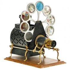 """American Gilded Age - Magic Lantern Projector, c.1890. Powered by a oil burner, with 10 glass colored slides. Named the, """"Pettibone - Sciopticon"""". Manufactured by: The Pettibone Bros. Company, Cincinnati, Ohio. ~ {cwl} ~ (Image: Live Auctioneers)"""
