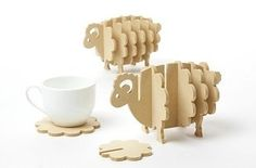 Holders that transform wooden coasters into pigs and sheep. | 31 Awesome And Inexpensive Things You Need For Your Kitchen