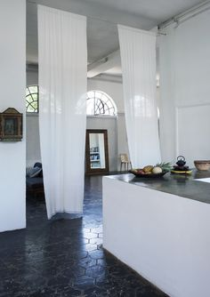 A Romantic/Industrial Milan Loft for a Bohemian Design Duo: Remodelista