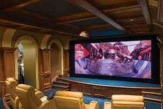 I would LOVE to have a home theatre room in my house!