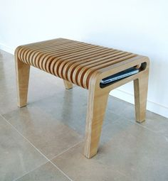 Thingamabob is both a table and seat, ideal for holding bits and bobs like books or an iPad