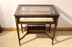 A beautiful Late Victorian Period rosewood inlaid bijouterie cabinet.
