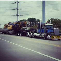 Kenworth W900L TriAxle with 3 axle dolly & a 2 axle stinger on the very rear......