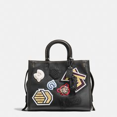 Intricate sport-inspired varsity patches update this spacious Rogue with a playful DIY vibe and graphic color. The bag is crafted in plump pebble leather with many thoughtful details, including a luxe suede lining, an interior kisslock pocket and detachable shoulder straps.