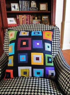 A colorful Log-Cabin style pillow cushion (by Mary Clyde) on a black & white chair Baby Pillows, Couch Pillows, Throw Pillows, Cute Cushions, Decorative Cushions, Patchwork Cushion, Quilted Pillow, Diy Pillow Covers, Cushion Covers