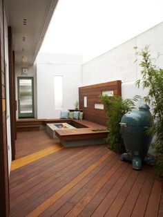 minimalist deck seating | beautiful home exterior wooden deck modern fireplace seating area