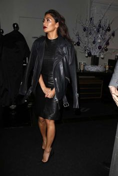 Nicole Scherzinger in leather and high heels
