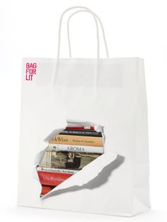 """The design has been created in conjunction with Lancashire's `Get It Loud in Libraries` scheme and Oneighty Creative. The idea was to create a unique and original design made from 100% recycled materials for library users to carry their books home in. The design is now in full mass production and will soon be used throughout Lancashire's 74 Libraries."""