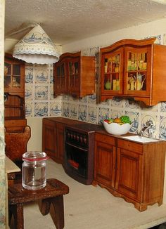 Dollhouse kitchen scene with lovely paper (?) lampshade that matches the wallpaper | Source: RD1630 via Flickr