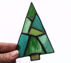 This is a pretty stained glass christmas tree. I used different shades of green stained glass and soldered a loop on the back for strength.