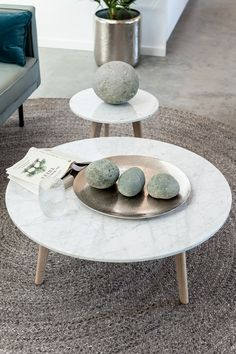 Ground your space with natural materials like marble and solid wood.