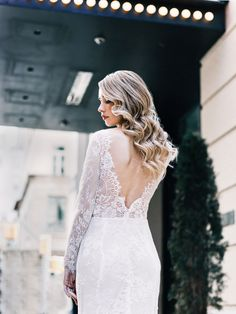 SELENA bridal gown featuring long lace sleeves and an open back by Goddess By Nature www.goddessbynature.com #bridal #bridalgown #weddingdress #weddinggown #bride #weddinginspiration