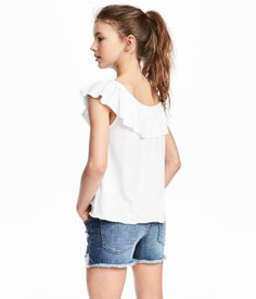 White. CONSCIOUS. Jersey top in an organic cotton blend with elastication and ruffle at neckline.