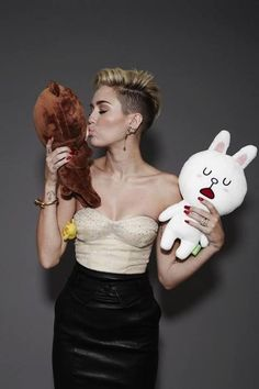 Miley Cyrus kissing a toy