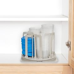 Chef Buddy Swirl Around 49 Piece Storage Organizer Blue - The Swirl Around 49 Piece Storage Organizer from Chef Buddy lets you preserve food and save storage space. This set includes 8 each of 8, 16 and 24 oz. containers, 24 interchangeable locking lids and a turning carousel that spins 360 degrees. Organiser Tupperware, Tupperware Organizing, Tupperware Storage, Food Storage Organization, Container Organization, Kitchen Storage, Storage Spaces, Bin Storage, Cabinet Storage