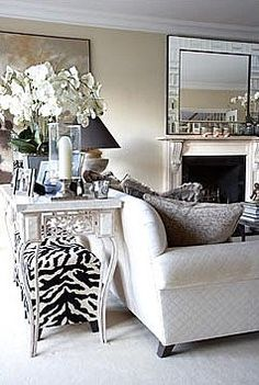 Great idea for for console table with bold ottoman under for extra seating