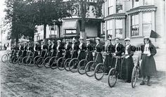 Photograph from between 1890 and 1900 of 18 women in dark dresses and light colored hats standing by bicycles. (Lakes Region History Online)