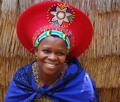 Zulu Bride: wearing the traditional red headdress, supposed to be woven from… African Hats, African Women, African Tribes, We Are The World, People Around The World, African Beauty, African Fashion, Tribal Fashion, African Style