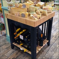 If you simply must have wine with your cheese, Gourmanoff® Gourmet Grocery aims to satisfy you. Here, an in-store Island Display serves up assorted cheeses from its Butcher-Block top and a selectio… Cheese Table, Cheese Platters, Baby Shower Finger Foods, Cheese Sauce For Broccoli, Cheese Design, Cheese Store, Cheese Display, Italian Bistro, Cheeseburger Recipe