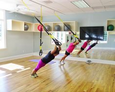 TRX Class.  Wellness amenities at Porters Neck Country Club include state of the art gym equipment, group exercise classes,massage therapy and personal training.