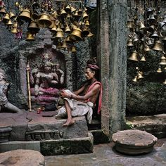 Steve McCurry, Man with Many Bells. Tranquil moment, though surrounded
