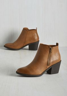 Your look tells a story, and while sporting these faux-leather booties, you project the message that your taste is the tops! Sleek, unique, and the epitome of urban chic, these tan booties offer exposed golden zippers, black block heels, and a huge helping of style that's true to you.
