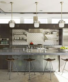 Ok this kitchen I could actually do now. Only minor adjustments from my existing one... More industrial and great at reflecting light to keep the space open.