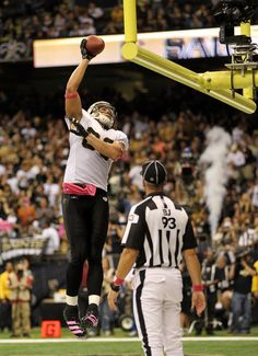 Jimmy Graham #80 of the New Orleans Saints dunks the ball over the goalpost after scoring a touchdown during the game against the Indianapolis Colts on October 23, 2011 at Mercedes-Benz Superdome in New Orleans, Louisiana.   (October 22, 2011 - Photo by Jamie Squire/Getty Images North America)