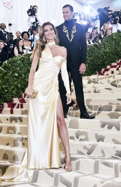 Glowing: Gisele Bundchen chose a ruched Versace gown; her husband Tom Brady also wore the ... #metgala