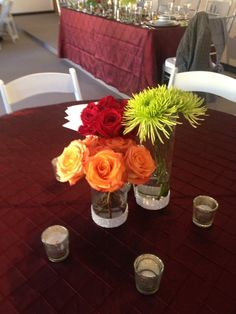 Cluster centerpiece with peach, red and green floral and bling