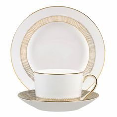 "Succumb to the fascination of fine gold and platinum on distinctive bone china. Wedgwood showcases the precious metal in the style of an intricate mesh on the ""Vera Wang Gilded Weave"" dinnerware. The platinum forming a fascinating weave pattern is edged with gold."