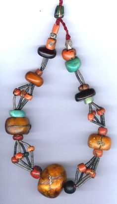 Africa | 'Primitive' style amber, coral, amazonite, jet and spring bead necklace from Au Ouaouzquit, Morocco | ©Linda Pastorino