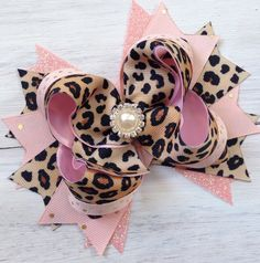 Cheetah and Pink Hair bow First Birthday Hairbow Headband Over the top Animal Print Hair Bow by ModernMeCollection on Etsy https://www.etsy.com/listing/252836468/cheetah-and-pink-hair-bow-first-birthday
