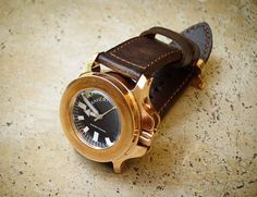 The Kaventsmann Triggerfish Bronze is quite literally bombproof, having been tested with 10 pounds of No joke. Clarks, World Watch, Bronze, Great Bands, Leather Working, Watches For Men, Men's Watches, Bracelet Watch, Women Wear