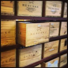 Empty wine crates are perfect for storage. What do we do with ours? We use them for filling! This is our wine crate wall, an ideal space to store various tid bits, and it looks so beautiful! #Reschke #sustainable #repurposed #upcycled #winecrates #DIY