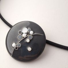 handmade enamel cloisonne pendant with fine silver wire. Amanda Lloyd Designs (www.etsy.com/shop/amandalloyddesigns)