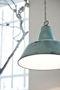 Industrial pendant lamp in a pastel turq- great way to incorporate soft accent colors into a neutral room.