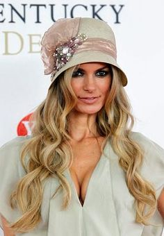 Model Marisa Miller arrives for the 137th Kentucky Derby horse race at Churchill Downs Saturday, May 7, 2011, in Louisville, Ky. (Darron Cummings/AP Photo)