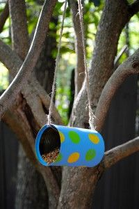 Homemade bird feeder perfect for a summer kids craft - and it could be hung outside their window so they could watch the birds eat.
