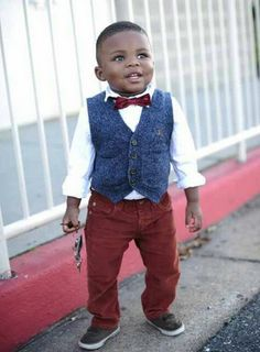 A pair of red pants with a gray vest and a matching red kid's size bow ties. Does it get more adorable than this?