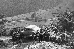 People bringing a vehicle to Kathmandu c. 1946. Before the construction of The Tribhuvan Highway in 1956, vehicles had to be carried through old route of Bhimbhedi-Kulekhani-Chitlang- Changdragiri pass and Thankot before it reached the valley.The history of Transportation in Nepal can be viewed here. Source:Old Nepal - Photos  Images