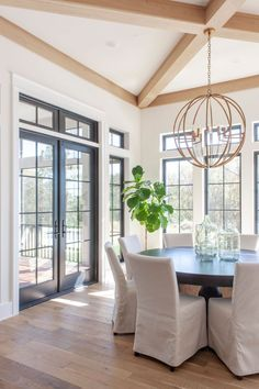 Nest — Scout & Nimble Dining room with three walls of windows + black trim windows + x beam on the ceiling + sphere chandHome Reveal White Oak Floors, White Walls, Black Walls, Light Oak Floors, Walnut Floors, White Dove Benjamin Moore Walls, Casa San Sebastian, Black French Doors, Home Interior