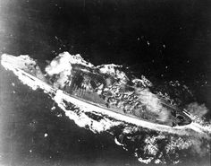 Battle of the Sibuyan Sea, 24 October 1944 Japanese battleship Yamato is hit by a bomb near her forward 460mm gun turret, during attacks by U.S. carrier planes as she transited the Sibuyan Sea. This hit did not produce serious damage.