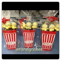 Popcorn shaped cake pops with movie tickets. I used these as prizes for a baby shower.