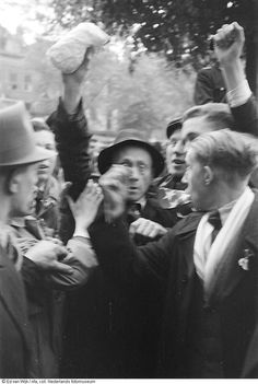 Arrest of Dutch nazi's in the center of The Hague, The Netherlands (may 1945).