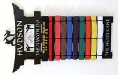 Martial Arts Belt Rack: To keep in mind for the boys once they have a few belts.