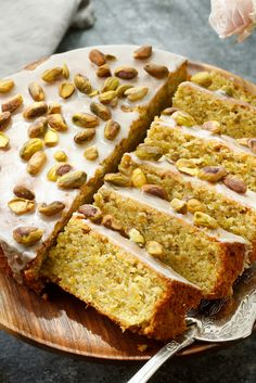 NYT Cooking: This fantastically moist pistachio cake, adorned with the simplest icing of confectioners' sugar and lemon juice, is adapted from Nigel Slater, the prolific British cookbook author. It is elegant and slightly exotic, rich with ground pistachios and almonds, orange zest and rosewater. And it's delightfully simple to throw together: once you've ground the nuts, you'll have it in the oven minutes.