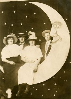 Vintage picture of people posing with moon photo prop. Just love the style.  A Paper Moon Date RPPC. $24.00, via Etsy. sold