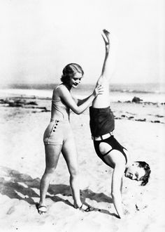 James Cagney receives assistance from an unknown starlet while training on the beach. 20s